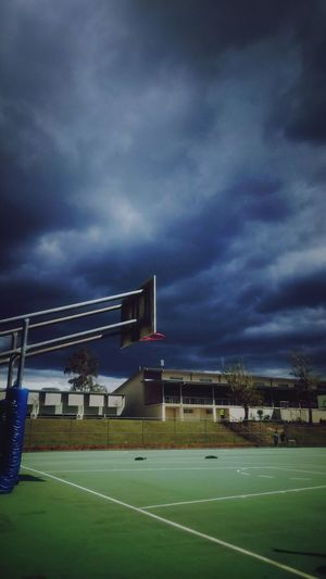 The Calm before the Storm. Built Structure Building Exterior Sky Cloud - Sky Storm Cloud Cloudy Cloud Cloudscape Dramatic Sky Day Outdoors Empty Road Atmospheric Mood Exterior First Eyeem Photo