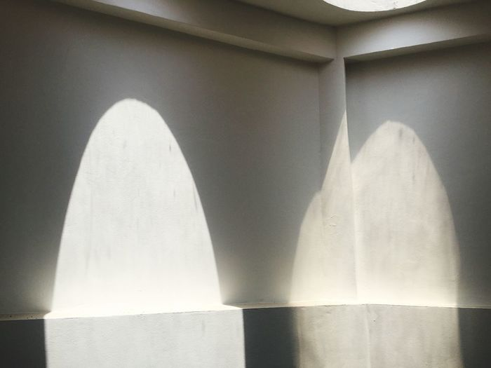 No People Indoors  Wall - Building Feature Architecture Shadow Sunlight Pattern Wall Creativity Arch Architectural Column Simplicity White Color Concrete Art And Craft Textured  Close-up Built Structure Day