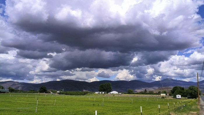 Now, Those are some Storm Clouds ! Check This Out Clouds And Sky Clouds Collection Dark Clouds Blue Sky Omak, Wa Washington State My Own Thing Light Behind Clouds Hills And Valleys Unenhanced My Point Of View Sky Cloudy Sky_collection Rural Wallpaper Rural America Showcase June My Year My View