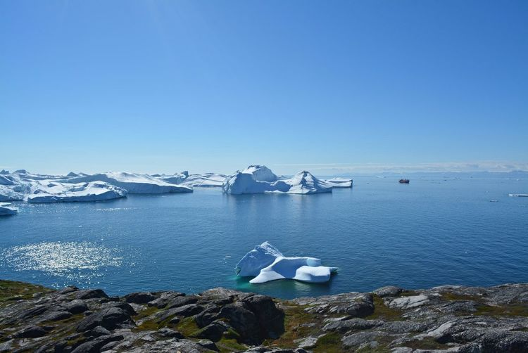 Ilulissat, Greenland, July | UNESCO world heritage site | impressions of Jakobshavn | Disko Bay Kangia Icefjord | huge icebergs in the blue sea on a sunny day | climate change - global warming Greenland Summer Day Nature Outdoors Hiking Travel Destinations Tranquility Cold Temperature Scenics - Nature Beauty In Nature Tranquil Scene Ice Iceberg Environment Water No People Explore Outdoor Photography Scenics Scenery Ilulissat Icefjord Europe Hikingadventures