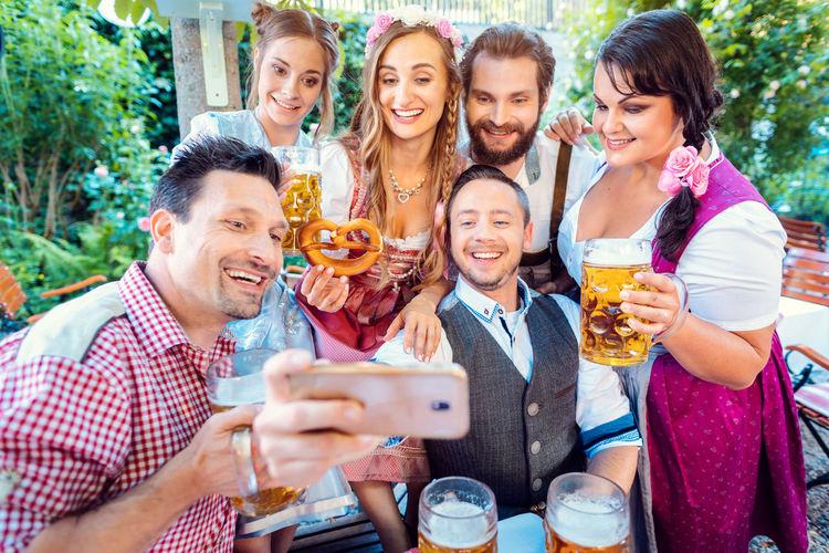 Portrait of smiling friends taking selfie