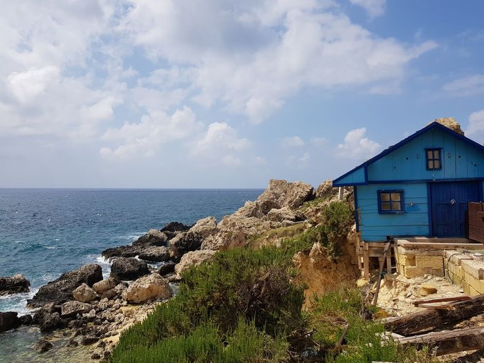 blue house by the sea Malta Mediterranean  No Filter Rocky Coastline Wooden Sea Beach Water House Sky Architecture Horizon Over Water Building Exterior Built Structure Cloud - Sky Coastline Coastal Feature
