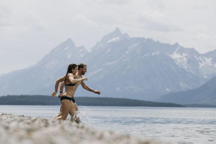 Full length of woman on mountain against sky