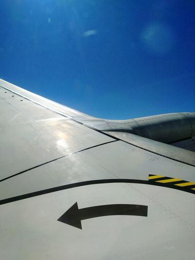 Close-up of cropped airplane against clear blue sky
