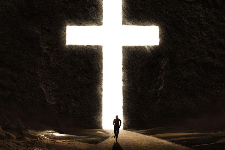 Digitally generated image of man running against cross