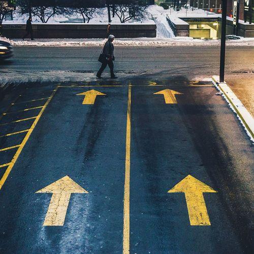 Man Crossing City Street
