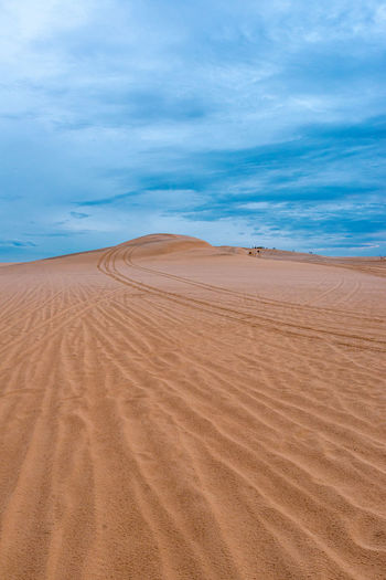 Desert Land Sand Environment Sand Dune Non-urban Scene Tranquil Scene Beauty In Nature Cloud - Sky Tranquility No People Arid Climate Climate Remote Nature Day Outdoors Vietnam Travel Destinations Travel Scenics - Nature Landscape Sky Pattern Tracks Imprints Cloudy