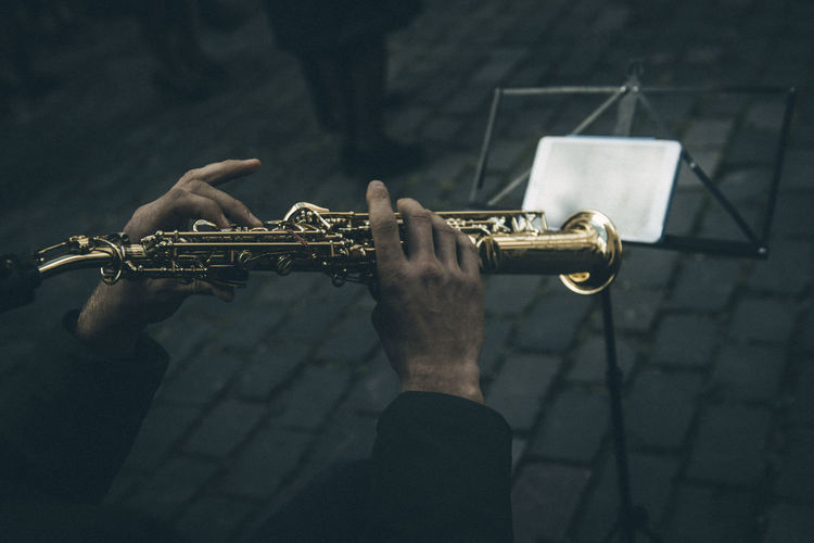 street music Music Artist Arts Culture And Entertainment Brass Instrument  Day Finger Focus On Foreground Holding Human Body Part Human Hand Leisure Activity Men Music Musical Instrument Musician One Person Performance Playing Real People Saxophone Skill  Streetphotography Trumpet Wind Instrument