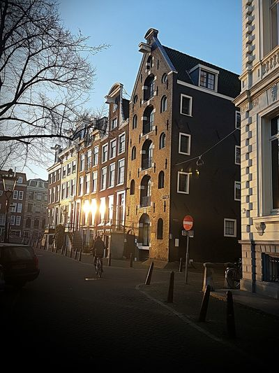 Sunrise Amsterdam Canal Amsterdam Street Photography Amsterdam Architecture Architecture Building Exterior Built Structure City City Life Outdoors Travel Destinations Sky Day Bare Tree People