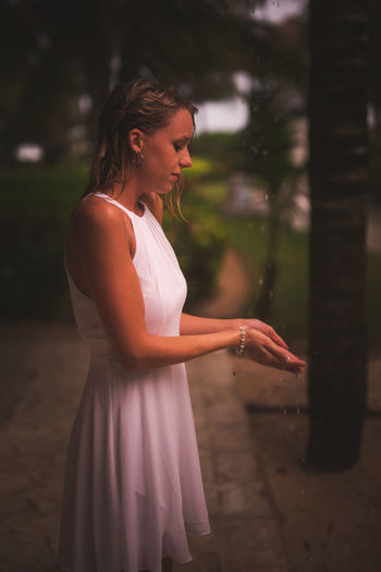 Beautiful Woman Day Focus On Foreground Human Hand Lifestyles Nature One Person Outdoors People Rainy Real People Side View Standing Tree Wet Young Adult Young Women