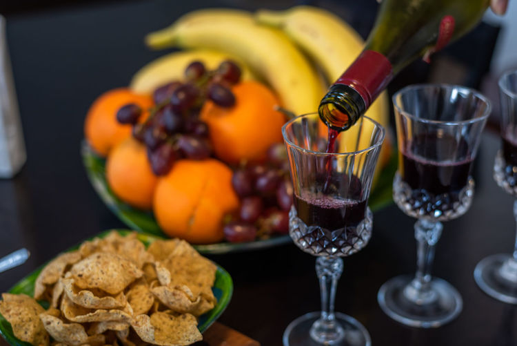 Food And Drink Food Freshness Glass Fruit Healthy Eating Drink Table Refreshment Indoors  Wellbeing Still Life Drinking Glass No People Ready-to-eat Close-up Wineglass Focus On Foreground Alcohol Wine Orange Red Wine Temptation Breakfast