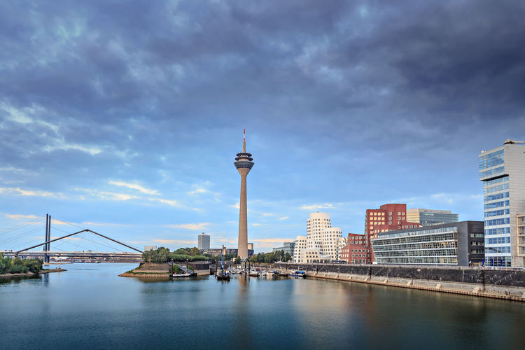 Rhine river boardwalk with view on Dusseldorf city in Germany City, Dusseldorf, Rhein River, Town, Architecture, Boardwalk, Building, Business, Center, Cityscape, Color, Culture, Destinations, Estate, Europe, European, Germany, House, Landmark, Landscape, Modern, Promenade, Rhine, Sightseeing, Skyline, Street, Touri