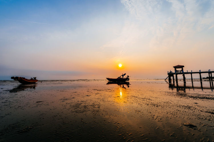 fishing boat in twilight time Water Sea Sunset Beach Silhouette Reflection Sand Sky Horizon Over Water Landscape Boat Sailing Boat