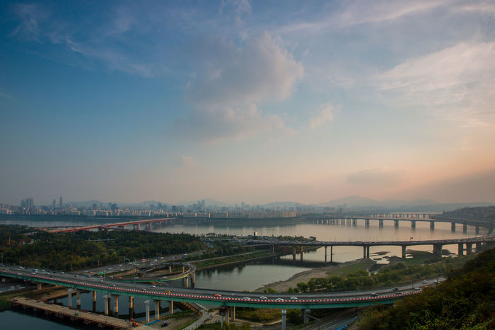 Cityscape of Seoul and Han river at late afternoon. South Korea. Han River Seoul Seoul, Korea Architecture Beauty In Nature Bridge - Man Made Structure Building Exterior Built Structure City Cityscape Cloud - Sky Connection Day Han River Bridge Nature No People Outdoors River Road Scenics Sky Sunset Transportation Water