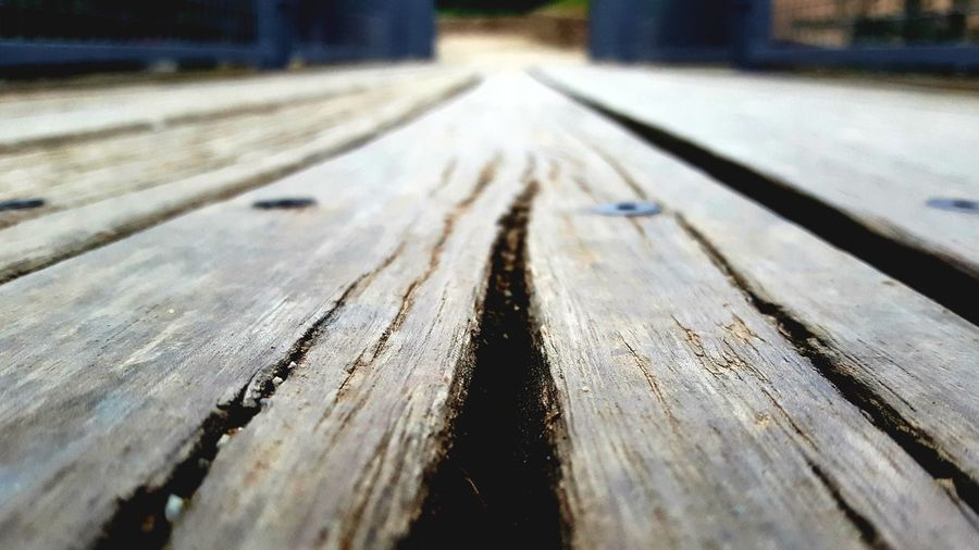 Nature Wooden Texture Wooden Structure Wooden Bridge Wooden Floor Gateway Runway Trip Destination Destinations Horizon Wooden Park Park - Man Made Space Road Prespective Streetphotography Low Angle View Wood - Material No People Day Close-up Outdoors Nature Railroad Track Shades Of Winter