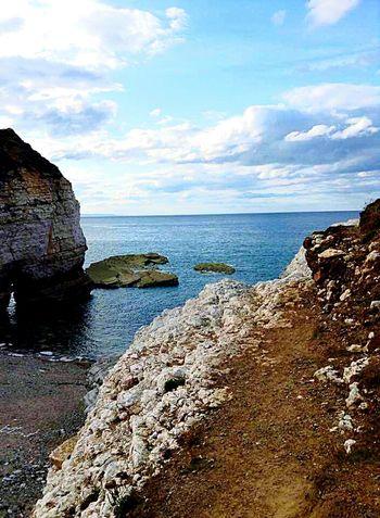 Enjoying The Sun Sea And Sky Sea Beach Rocks Stone Cliffs Nature Clouds Long Walks