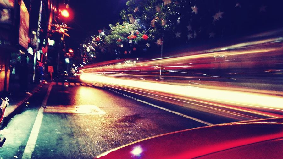 Catch 'em tail lights. Light Trail City Night Car Long Exposure Motion Speed City Street Outdoors No People Transportation Road P9LitePhilippines Mobilephotography Huaweiphotography