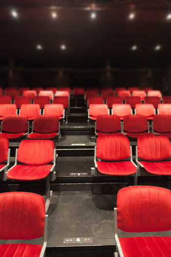 Empty red chairs in theater