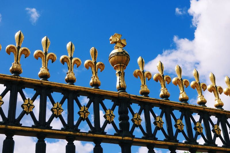 Low Angle View Of Iron Fence Against Sky At Buckingham Palace