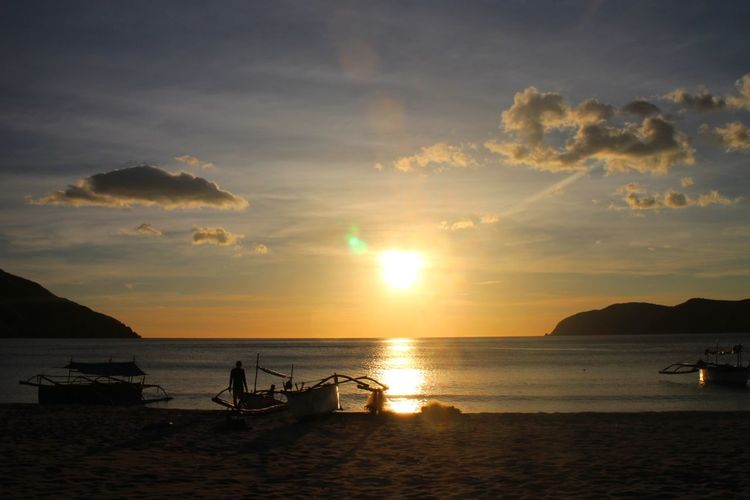 sunset by the beach Sunset Sea Travel Beach Water Travel Destinations Cloud - Sky Outdoors Beauty In Nature Tranquility Tourism Nature Sky Scenics Landscape Sailing Ship Nagsasa Cove Nagsasa Cove Zambales Zambales Philippines