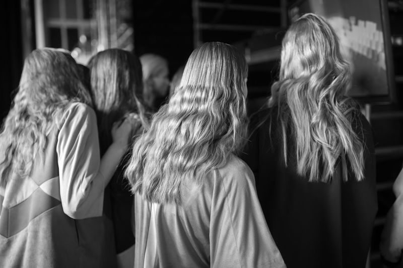 Rear View Of Fashion Models In Backstage