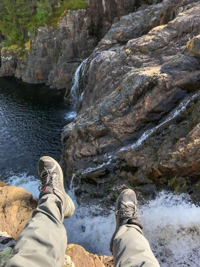 By the waterfall Adventure Outdoor Life Hiking Waterfall Low Section Shoe Real People Human Leg Personal Perspective Lifestyles Leisure Activity Nature Water Unrecognizable Person Outdoors