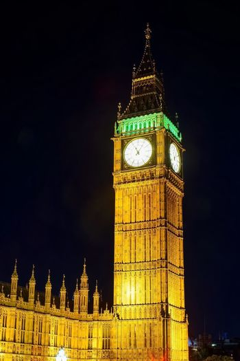 Postcode Postcards Night Illuminated Clock Tower Travel Destinations Architecture Tower Built Structure Clock Building Exterior Low Angle View Sky Government Time Outdoors No People City Politics And Government Clock Face