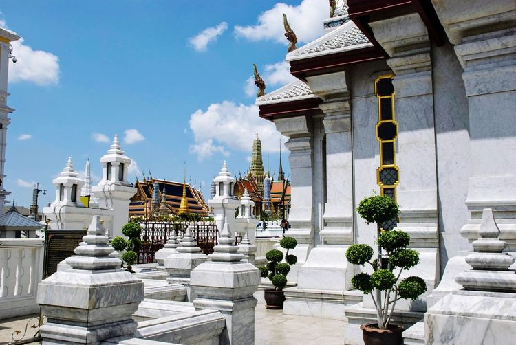 Ornamented towers of buddhist temple in bangkok, thailand