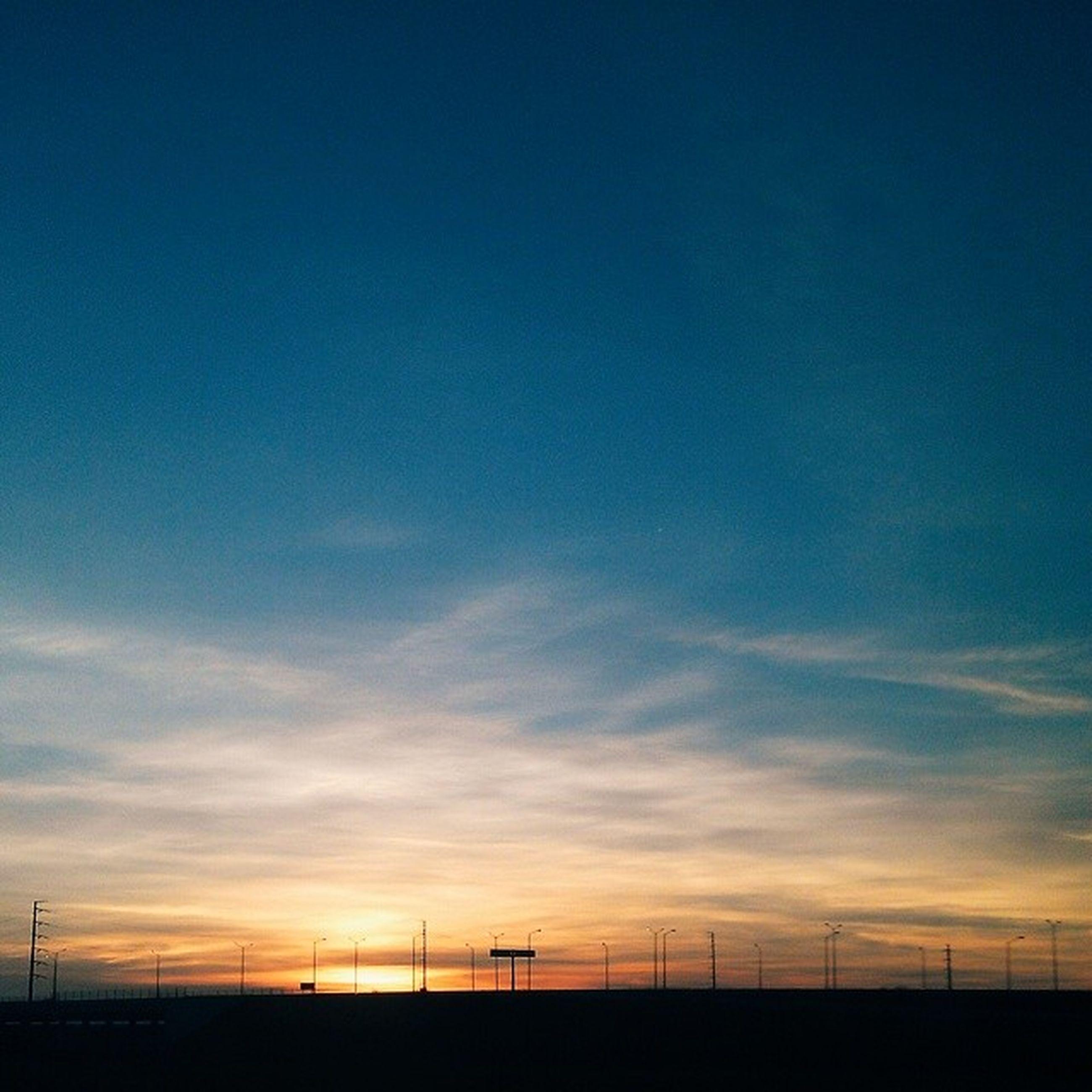 sky, sunset, scenics, tranquility, tranquil scene, landscape, beauty in nature, blue, silhouette, field, nature, cloud - sky, cloud, fence, idyllic, horizon over land, dusk, copy space, outdoors, orange color