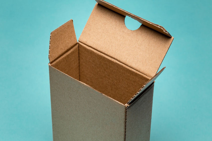 close up of small open cardboard pack Box Cardboard Paper Container Blue Cardboard Box Box - Container Studio Shot No People Brown Indoors  Colored Background Still Life Brown Paper Blue Background Close-up Stack Carton Single Object Copy Space Package Turquoise Colored