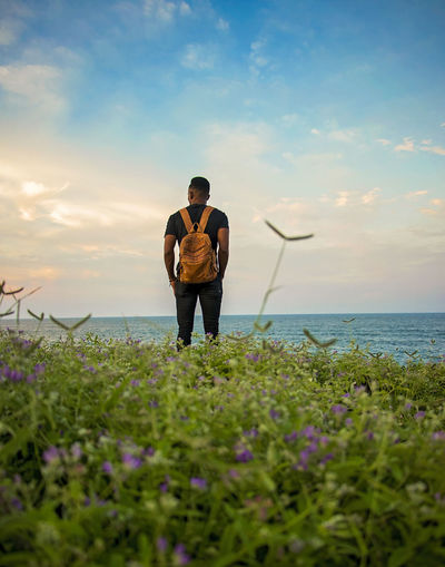Full length of man standing by sea against sky