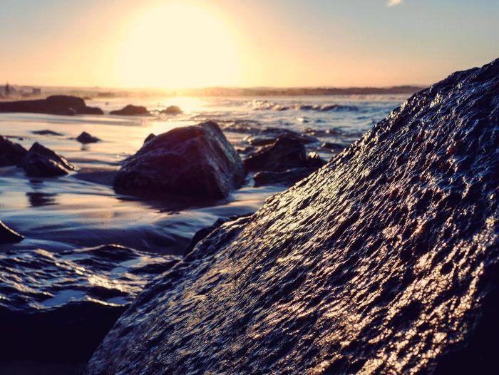 Last rays of day Beach Kirra Gold Coast Queensland Australia Rock Sunset Dusk Afternoon Ocean Seaside Sun