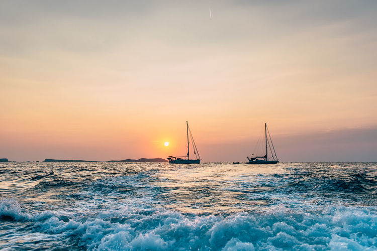 Beauty In Nature Horizon Horizon Over Water Motion Nature No People Outdoors Sailboat Sailing Scenics - Nature Sea Sky Sun Sunset Travel Water Wave