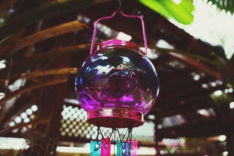 As round as this purple chime, the wind blows will make a rhyme, the melody whispers into your ear, burn away all anxiety and fear. Chimes No People Focus On Foreground Low Angle View Close-up Decoration Indoors  Sphere Glass - Material Hanging Glass Reflection Day Multi Colored