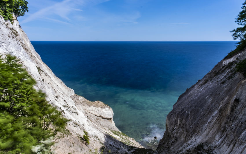 View from the chalk cliff at Möns Klint. Chalk Cliffs Denmark Beach Beauty In Nature Blue Cliff Day Horizon Horizon Over Water Idyllic Island Møn Land Møns Klint Nature No People Non-urban Scene Outdoors Plant Rock Scenics - Nature Sea Sky Tranquil Scene Tranquility Water