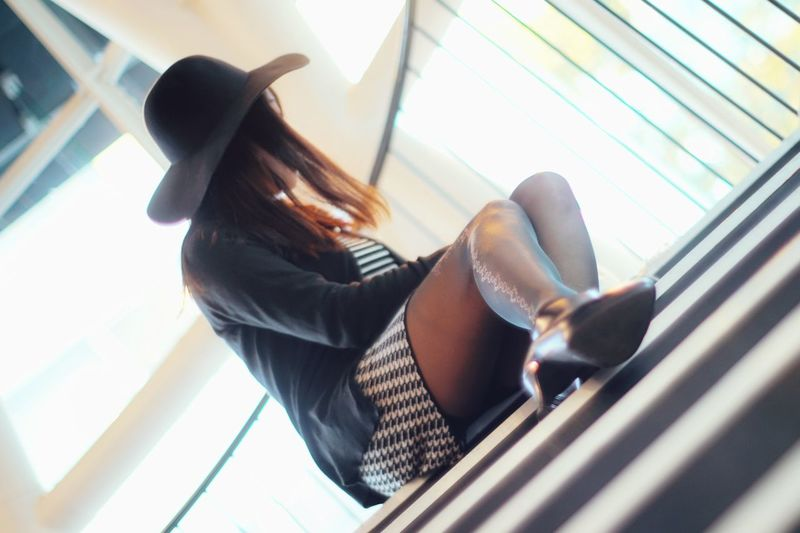 Low angle view of woman sitting on staircase
