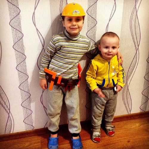 Child Casual Clothing Childhood Two People Boys Portrait Standing Togetherness Indoors  Looking At Camera People Males  Full Length Happiness Smiling Adult Children Only Day Hardhat