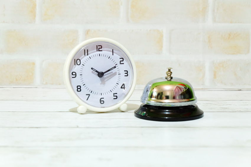 Ring bell and table clock. Ring Bell Alarm Bell Ting Hotel Lobby Motel Office Front Desk Front Counter Backgrounds Object Time Clock Indoors  No People Clock Face Day Minute Hand