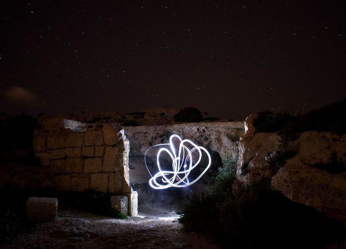 Graffiti on wall at night