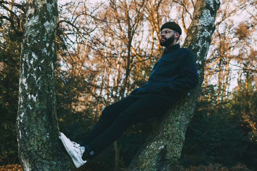 Hanging around Tree One Person Real People Lifestyles Nature Full Length Day Tree Trunk Sitting Forest Leisure Activity Outdoors Winter Beauty In Nature Warm Clothing Cold Temperature EyeEm Best Shots