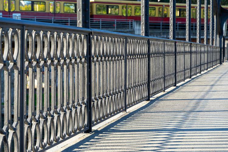 Metal fence on footpath
