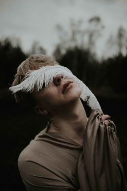Man Blond Hair Close-up Day Emotional Feather  Focus On Foreground Headshot One Person Outdoors People Real People Sensitive Touching Young Adult