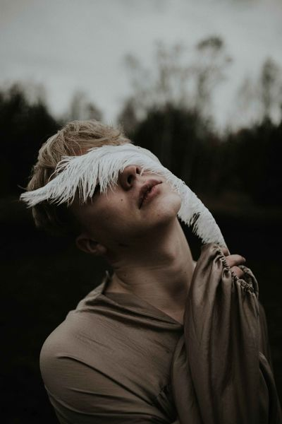 Man Blond Hair Close-up Day Emotional Feather  Focus On Foreground Headshot One Person Outdoors People Real People Sensitive Touching Young Adult The Portraitist - 2018 EyeEm Awards