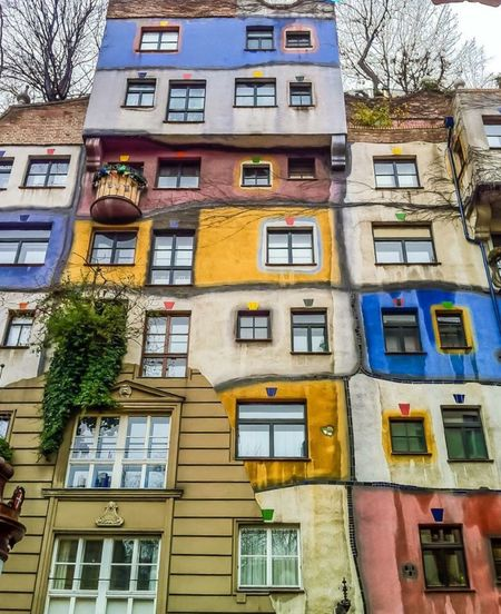 Hundertwasserhaus in Vienna Architecture Building Exterior Window Built Structure No People Outdoors City Tree The Architect - 2017 EyeEm Awards The Architect - 2017 EyeEm Awards Streetphoto Street Photography Windows Colourful Colours EyeEmNewHere