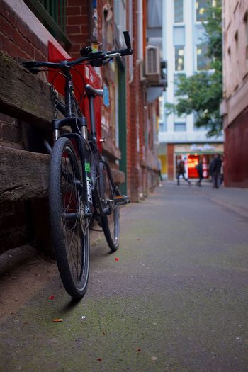 Bicycle Transportation Mode Of Transport Land Vehicle Architecture Building Exterior Stationary Built Structure Street Outdoors Red Day No People City