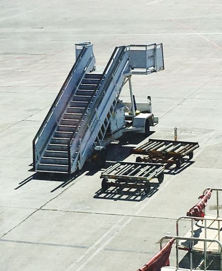 Waiting for work... Gangway Acces Stair Entrance Stairs Stairway Stair Airport Outdoors No People Baggage Flight Baggage Baggage Car
