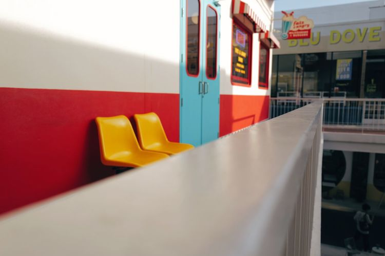 Close-up of yellow car on table against wall
