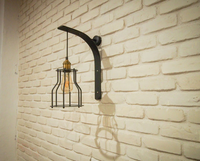 Retro lantern on a white brick wall Antique Architecture Brick Wall Lantern Living Room Bulb Decoration Design Electricity  Furniture Home Interior Indoors  Lamp Old Pattern Retro Styled Structure Vintage White