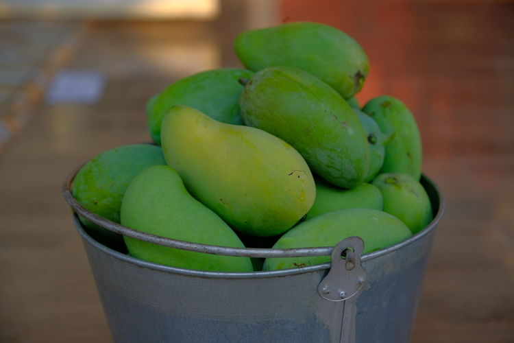 Close-up of green fruits on table at market