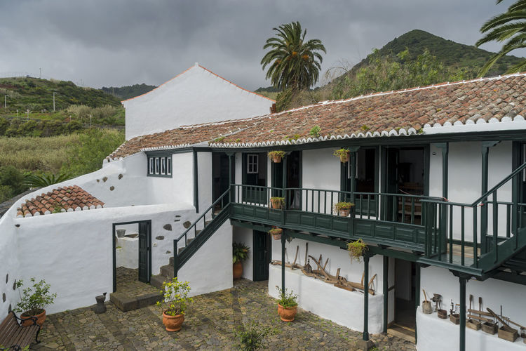 La Palma, Canarias Canary Islands SPAIN Travel Architecture Built Structure Building Exterior Building Mountain House Plant Nature Day Roof No People Sky Tree Residential District Outdoors Railing Palm Tree Beauty In Nature Land Tropical Climate Roof Tile